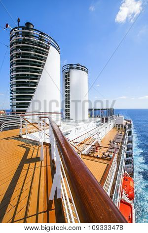 Cruise Ship. Tourists Relax And Take A Sun Bath On The Upper Deck