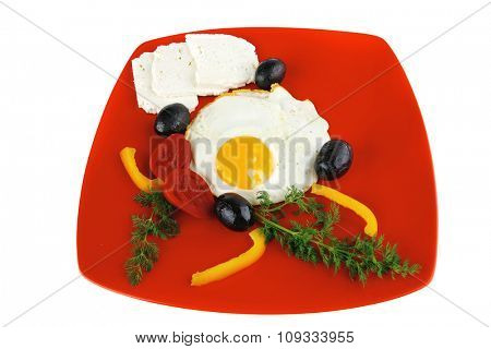 fried scrambled eggs eye with white goat feta cheese on red plate isolated over white background with black olives and vegetables