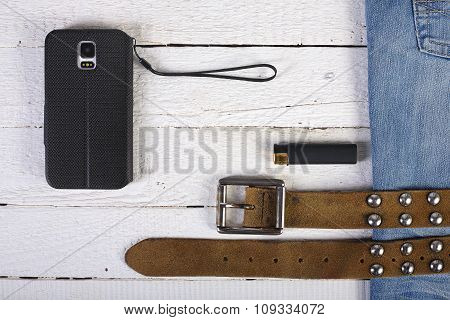 Planks, Phone, Lighter Blue Jeans And Belt