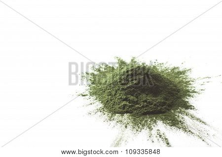 Spirulina raw powder on white background - heap.
