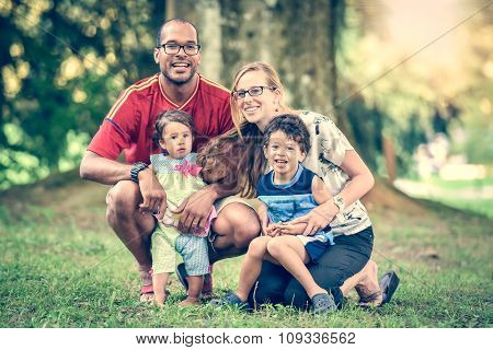 Happy Interracial Family Is Enjoying A Day In The Park