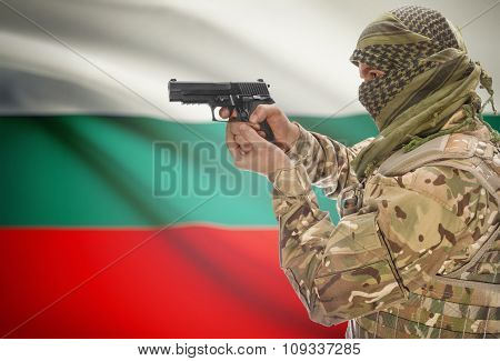 Male In Muslim Keffiyeh With Gun In Hand And National Flag On Background - Bulgaria