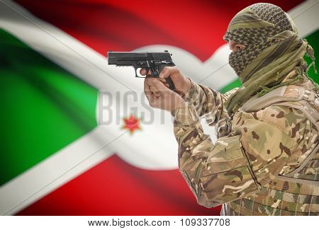 Male In Muslim Keffiyeh With Gun In Hand And National Flag On Background - Burundi