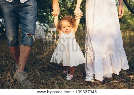 Young family walking in the garden