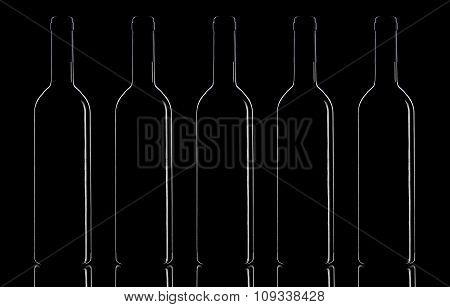 Wine Bottles On A Black Background