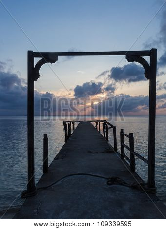 Wooden Arch On An Abandoned Pier