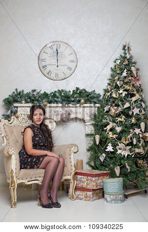 Young woman at Christmas tree. New Year content