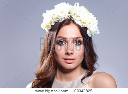 Portrait of a beautiful woman with flowers in her hair. Fashion