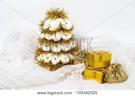 Homemade White Christmas Tree With Tinsel And Box With Gifts