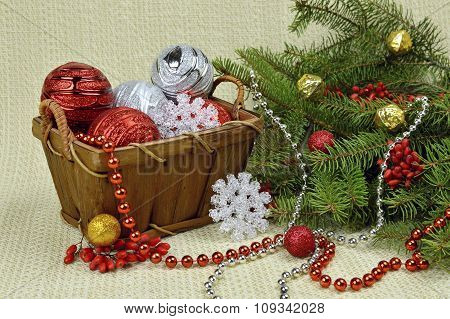 A Christmas Tree Decorated In A Rustic Style, Berries And Toys.