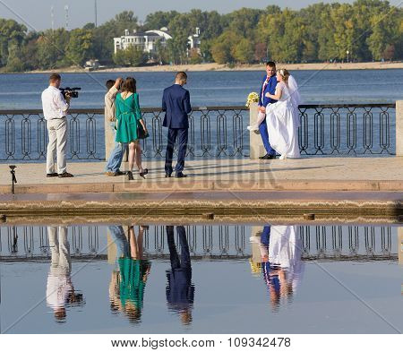 Kiev, Ukraine - September 18, 2015: The Photographer And Videographer Working With The Newlyweds On
