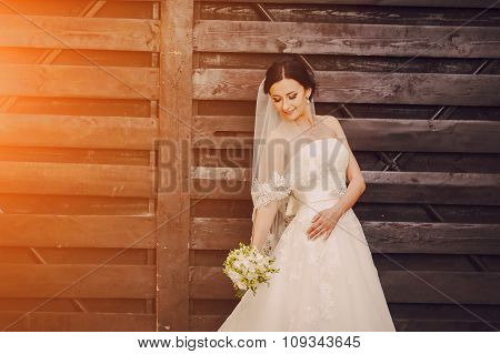 Bride at  wooden wall