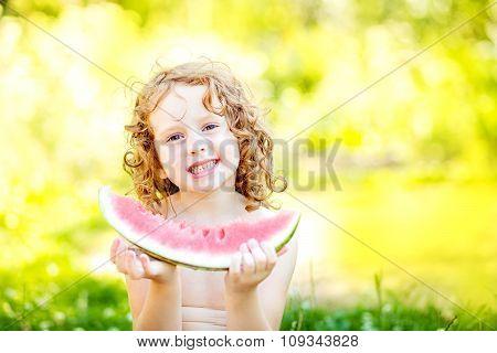 Happy Little Girl Eating Watermelon  In Summer Park