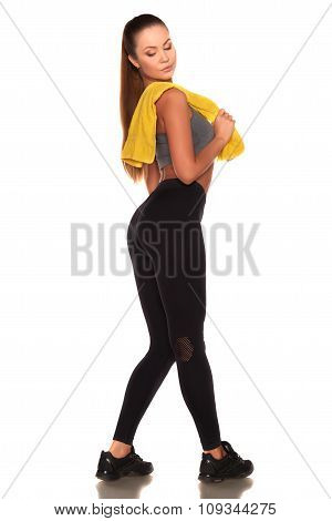 Fitness woman in sport style standing against isolated white background