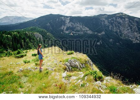 Woman Relax And Look At Fascinating Landscape Of Mountains