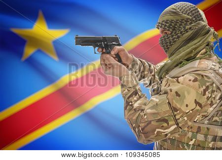Male In Muslim Keffiyeh With Gun In Hand And National Flag On Background - Congo-kinshasa