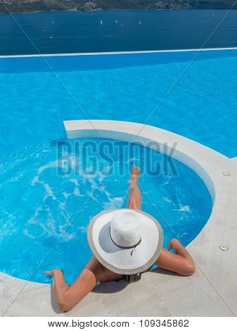 Young woman having good time in swimming pool