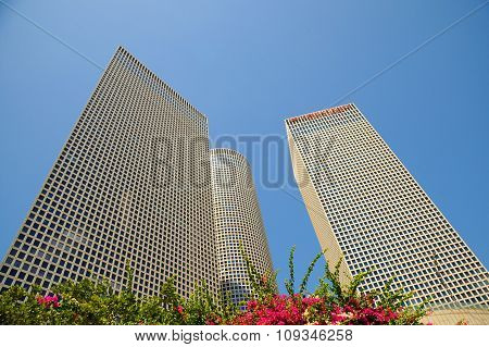 Azrieli Center in Tel Aviv on a clear blue sky. The round building is the tallest in Tel Aviv