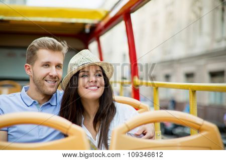 Young couple in the tour bus