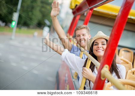 Smiling couple in the tour bus