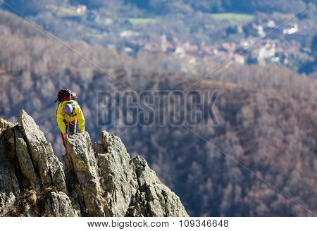 Climber struggle to the summit of a challenging ridge. Sunny autumn day. Italian Alps, Europe.