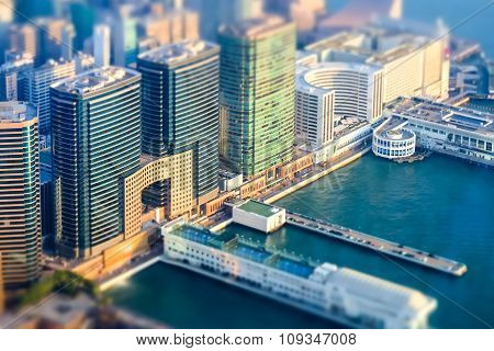 Tilt Shift Effect. Aerial View Of Hong Kong Island With Port Terminal