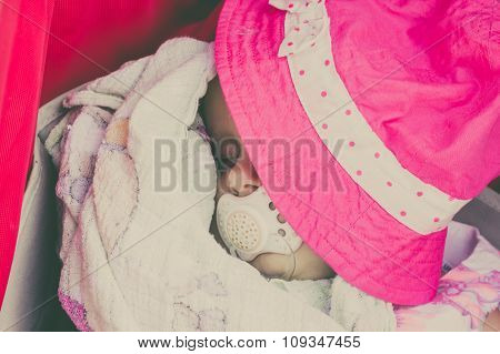 Closeup Of Little Baby Covered With Pink Hat.