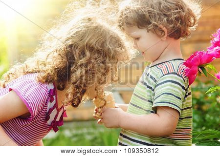 Happy Children Eating Ice-cream In Summer Park. Instagram Filter. Sun Backlight.
