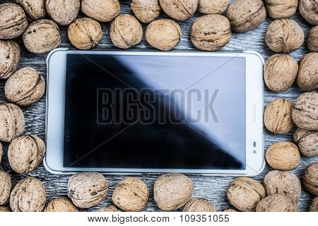 Plenty of walnuts with tablet pc