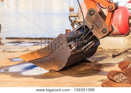 Excavator Working At Sea.