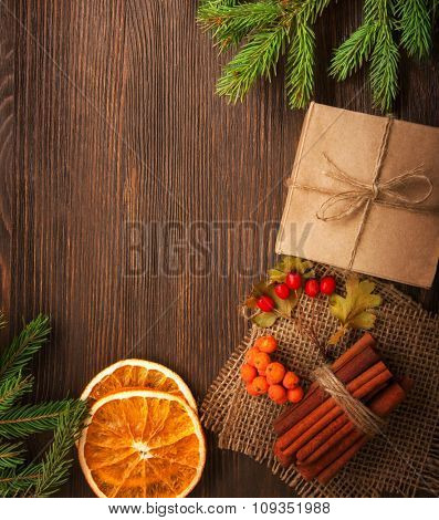Christmas tree with gift box and decorations on wooden background space for lettering