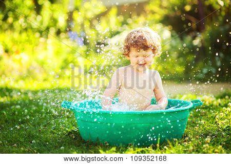 Water Procedures In Summer Garden.