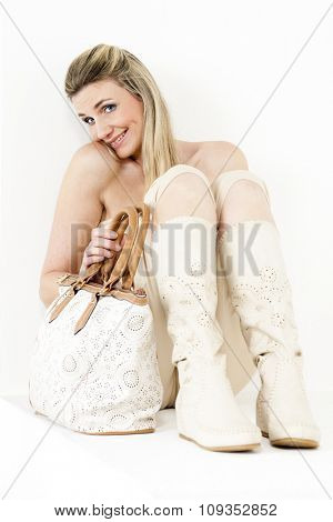 sitting woman wearing summer clothes and boots