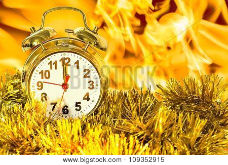 Alarm Clock In The Tinsel Against The Flames