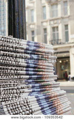 stack of the newspapers in the city , London , financial capital of Europe