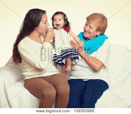 happy family portrait - baby, woman and old lady on white