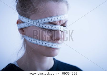 Tape Measure Wrapped Around Head