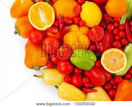 Close-up composition of various raw organic vegetables isolated on white
