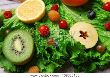 Beautiful bouquet of fruits and vegetables on grey wooden background, close up