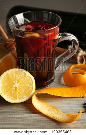 Beautiful composition of traditional mulled wine with decorations on the table