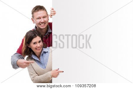 man adm woman pointing at empty blank for advertisement isolated on white background