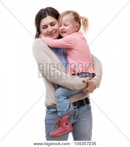 mother with little daughter in her arms hugging isolated on white background