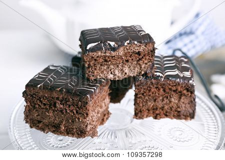 Served table with chocolate cakes close-up