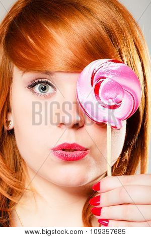 Redhair Girl With Pink Lollipop