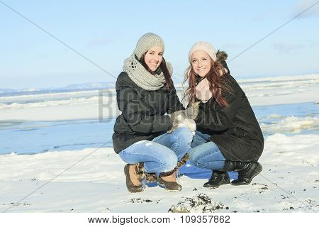 Two happy young girls winter