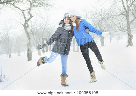 happy young girls having fun in winter park