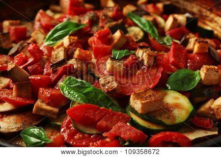 Tasty vegetarian ratatouille in black cast iron pan, close-up