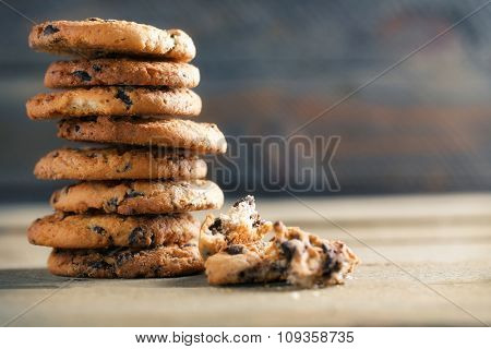 Cookies with chocolate crumbs on wooden table, close up