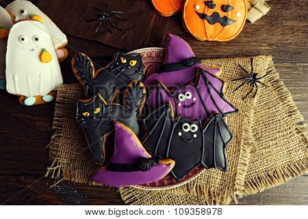 Creative Halloween cookies on wooden background