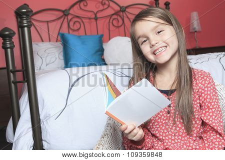 little girl bedroom with a book